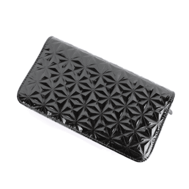 Closed black shiny scissorcase with geometric pattern